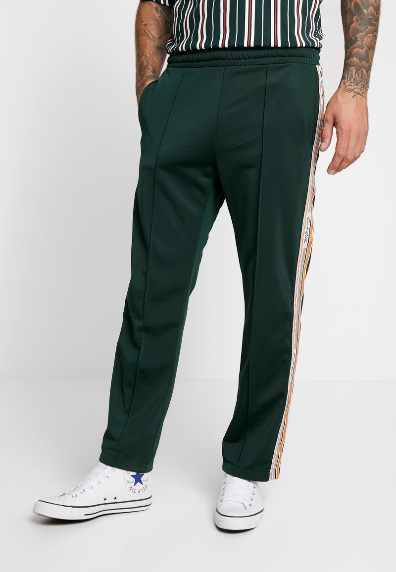 Sweet SKTBS - Tracksuit bottoms - green