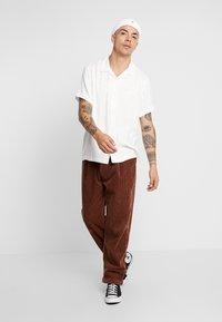 Sweet SKTBS - SWEET 80'S - Trousers - brown - 1