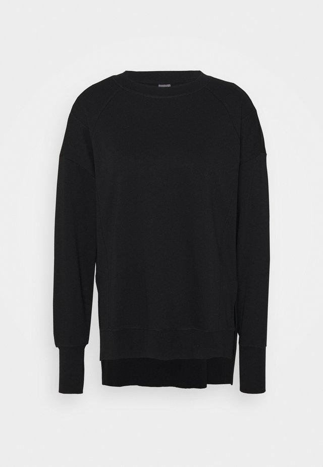 SIMHASANA - Sweatshirt - black