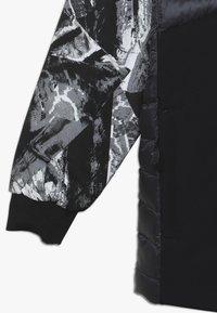 Spyder - BOYS DYLAN - Lyžařská bunda - black - 2