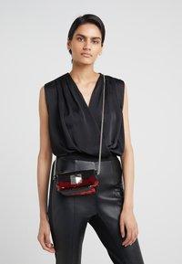 Sonia Rykiel - COPAIN LE COPAIN - Across body bag - black/red - 1