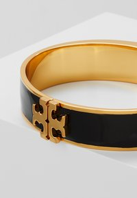 Tory Burch - RAISED LOGO THIN HINGED BRACELET - Bracelet - black/gold-coloured