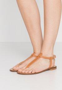 Trussardi Jeans - T-bar sandals - tan - 0