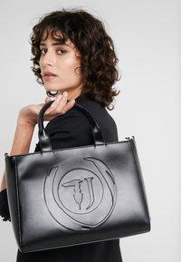 Trussardi Jeans - FAITH SMOOTH SHOPPER - Handbag - black - 1