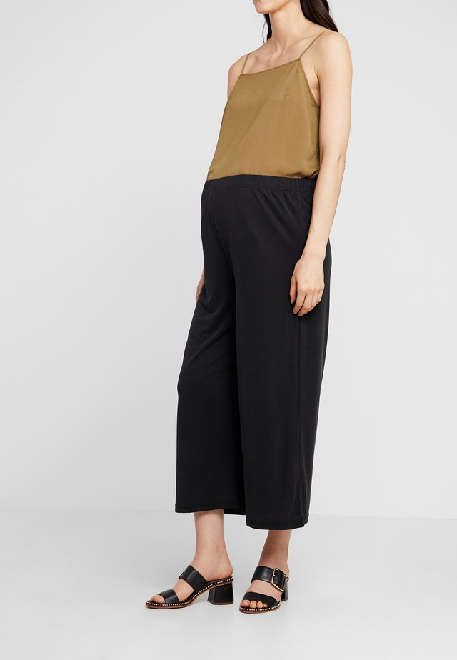 CUPRO CROP WIDE - Tygbyxor - black