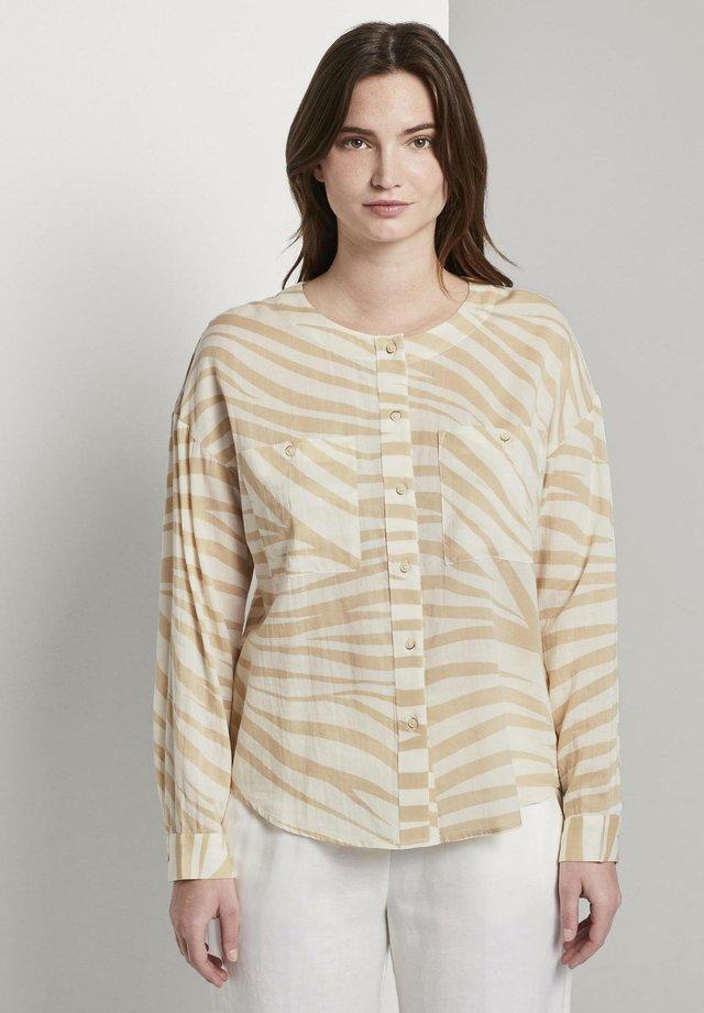 FLIESSENDE MIT ZEBRA-MUSTERUNG - Button-down blouse - ecru zebra design