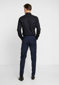 Tommy Hilfiger Tailored - FLEX SLIM FIT SUIT - Kostym - blue - 5