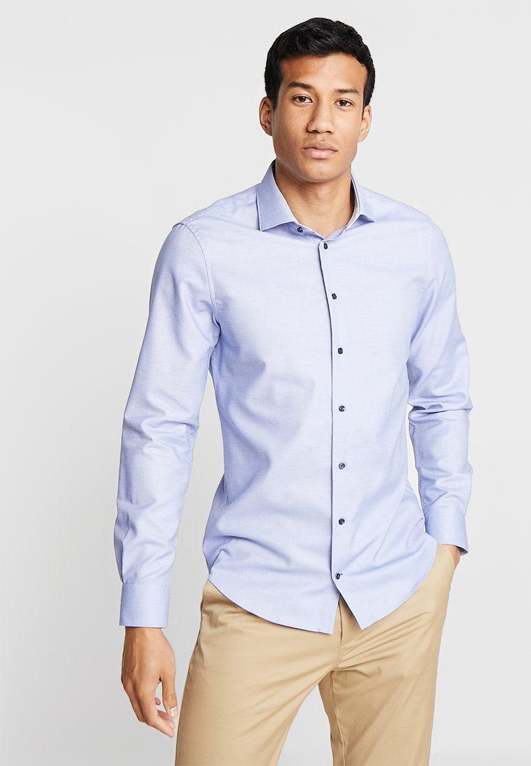 Tommy Hilfiger Tailored - DOBBY CLASSIC SLIM FIT - Formal shirt - blue