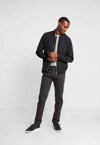 Tommy Hilfiger Tailored - PANTS - Chino - black - 1