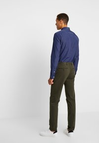 Tommy Hilfiger Tailored - STRETCH PANTS - Chino - green - 2