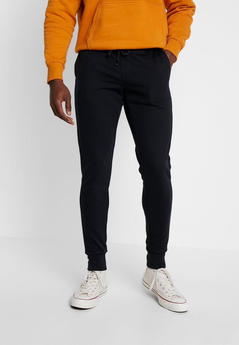 Tommy Hilfiger Tailored - TECH PANT - Pantalones deportivos - black