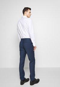 Tommy Hilfiger Tailored - SLIM FIT FAKE SOLID SUIT - Garnitur - blue - 5