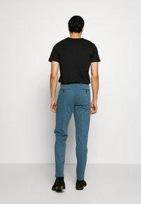 Tommy Hilfiger Tailored - STRETCH SLIM FIT PANTS - Pantaloni - blue - 2