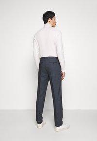 Tommy Hilfiger Tailored - HERRINGBONE SLIM FIT PANTS - Trousers - black - 2