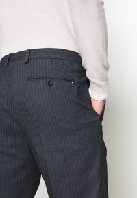 Tommy Hilfiger Tailored - HERRINGBONE SLIM FIT PANTS - Trousers - black - 4