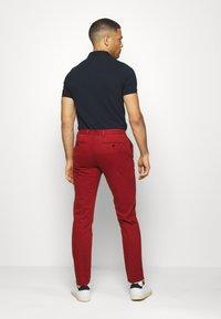Tommy Hilfiger Tailored - FLEX SLIM FIT PANT - Pantaloni - red - 2