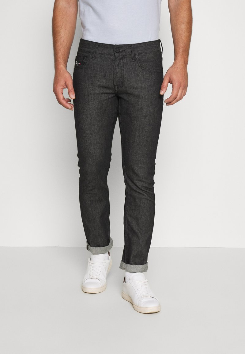 Tommy Hilfiger Tailored - TOMMY X MERCEDES-BENZ - Slim fit jeans - black