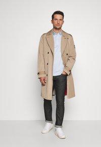 Tommy Hilfiger Tailored - TOMMY X MERCEDES-BENZ - Slim fit jeans - black - 1
