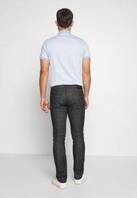 Tommy Hilfiger Tailored - TOMMY X MERCEDES-BENZ - Slim fit jeans - black - 2