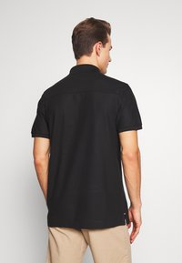 Tommy Hilfiger Tailored - TOMMY X MERCEDES-BENZ - Polo shirt - black - 3