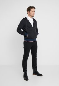 Tommy Hilfiger Tailored - TECH ZIP THRU - Sweatjacke - black - 1
