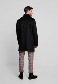 Tommy Hilfiger Tailored - STAND UP COLLAR OVERCOAT - Classic coat - black - 2