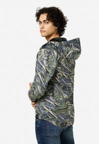 Tretorn - BLEETER - Waterproof jacket - rapa valley - 1