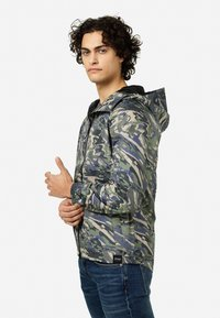 Tretorn - BLEETER - Waterproof jacket - rapa valley - 2