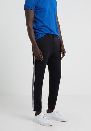 TERRACE TECH FACE PONTE - Trousers - black