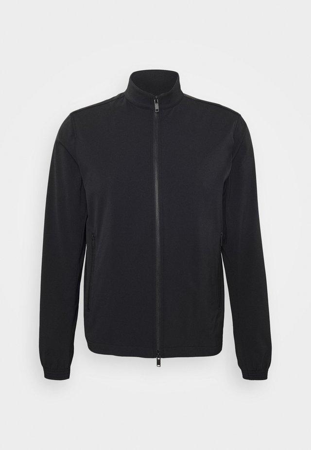 TREMONT - Lehká bunda - black