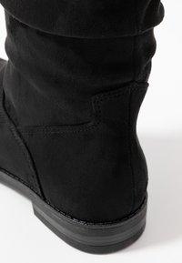 Tamaris - Høye støvler - black - 2