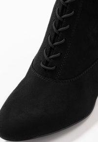 Tamaris - Šněrovací vysoké boty - black - 2