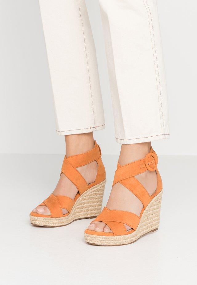 Sandalen met hoge hak - sunset