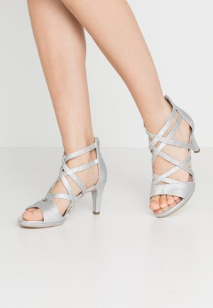 Sandaalit nilkkaremmillä - silver glam