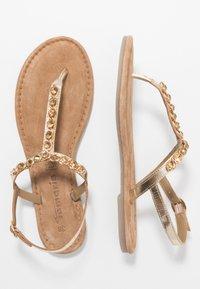 Tamaris - T-bar sandals - gold - 1