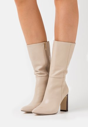 High heeled boots - ivory