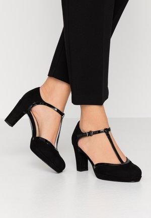 WOMS SLIP-ON - Scarpe con plateau - black