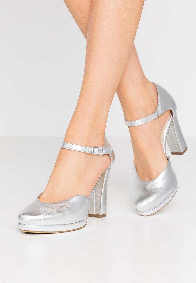 Højhælede pumps - silver