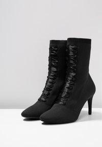 Tamaris - Kotníkové boty - black - 4