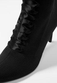 Tamaris - Kotníkové boty - black - 2