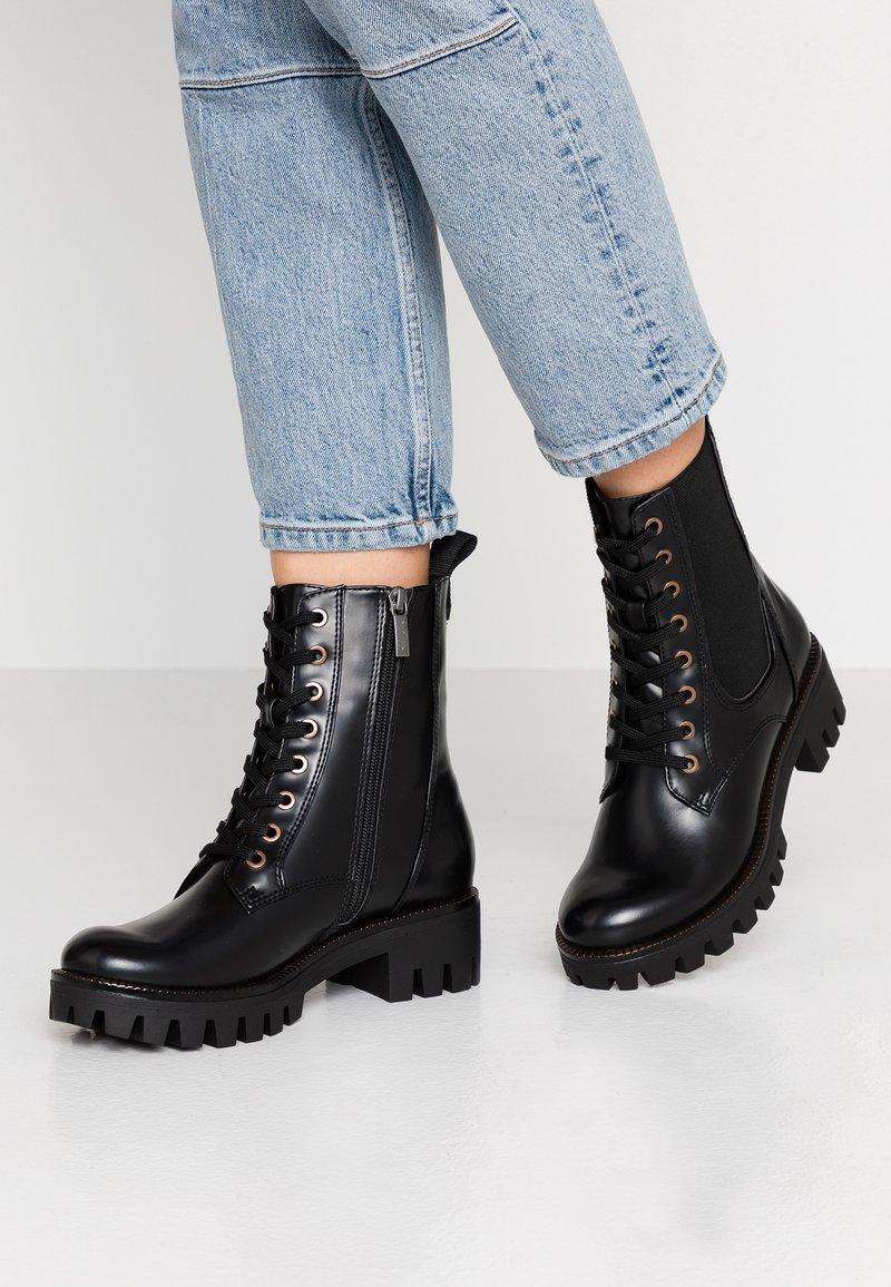 Tamaris - Platform ankle boots - black