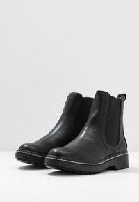 Tamaris - Kotníkové boty na platformě - black - 4