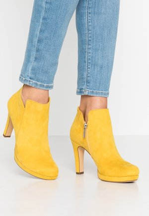 High heeled ankle boots - sun