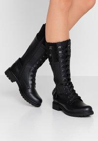 Tamaris - Šněrovací vysoké boty - black - 0