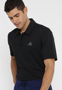 adidas Golf - ULTIMATE365 SOLID - Sports shirt - black/grey four - 0