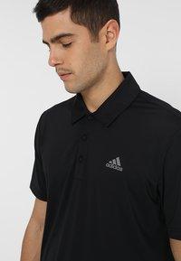 adidas Golf - ULTIMATE365 SOLID - Sports shirt - black/grey four - 5