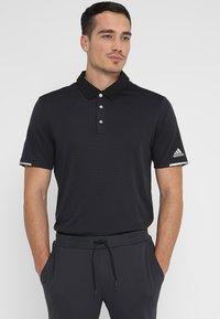 adidas Golf - CLIMACHILL TONAL STRIPE - T-shirt sportiva - black - 0