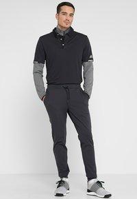 adidas Golf - CLIMACHILL TONAL STRIPE - T-shirt sportiva - black - 1