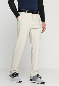 adidas Golf - ADIPURE TECH PANTS - Trousers - clear brown - 0