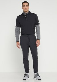 adidas Golf - ADICROSS RANGE JOGGER PANTS - Tracksuit bottoms - carbon - 1